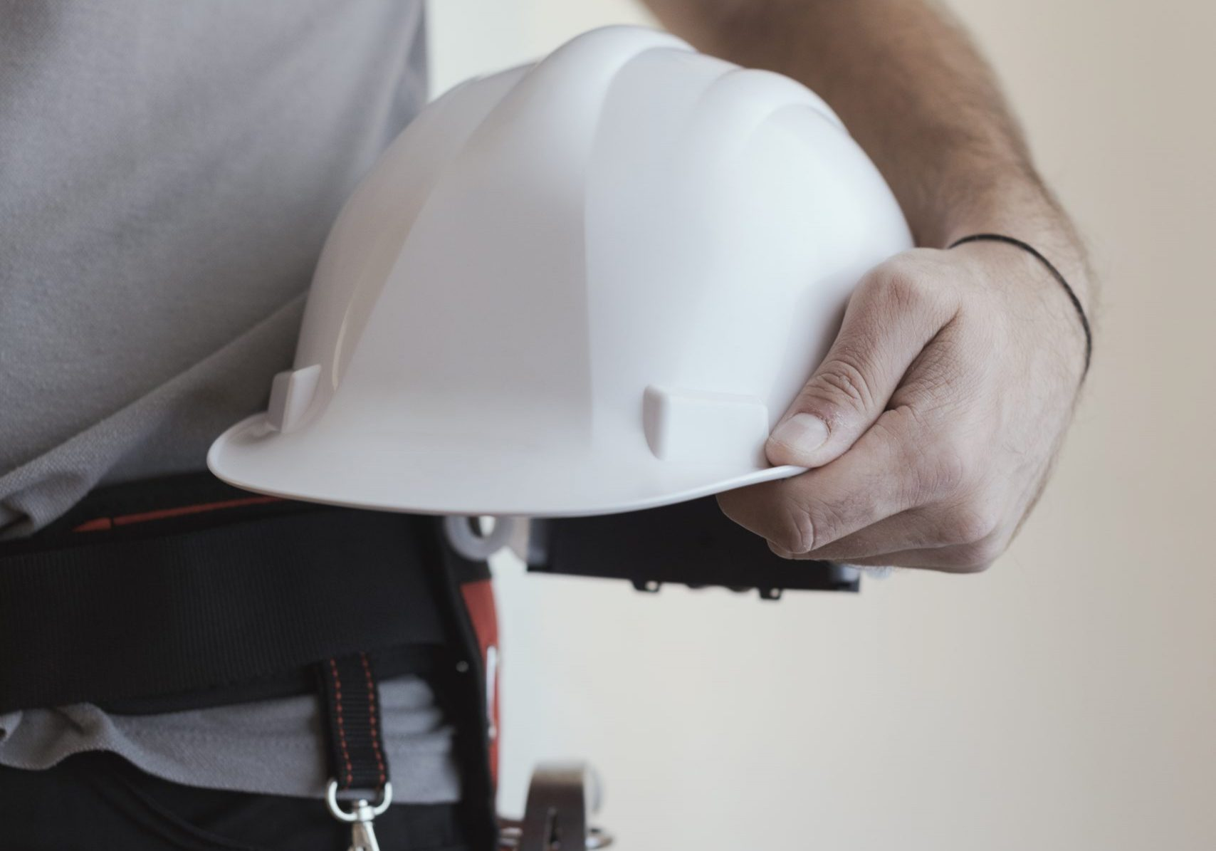 Picture of a man holding Construction Helmet